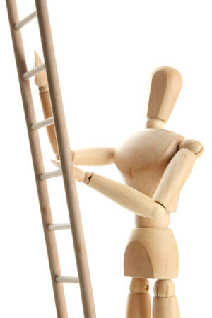 Mannequin on wooden ladder, isolated on  white Stock Photo - 17822851