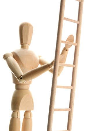 Mannequin on wooden ladder, isolated on  white Stock Photo - 17823077
