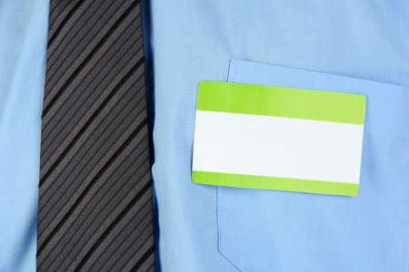 nametag: Blank nametag on businessmans blue shirt close up