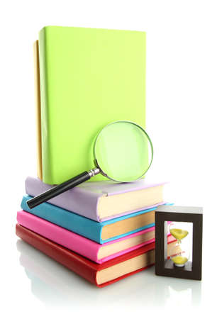 color books with magnifying glass isolated on white Stock Photo - 17864052
