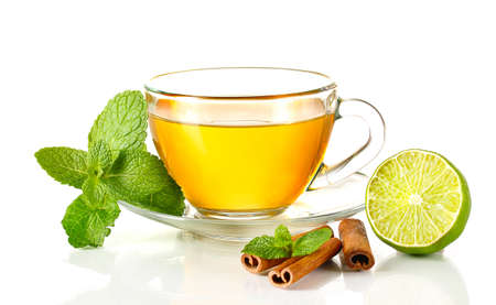 cold weather: Cup of tea with mint,cinnamon and lime isolated on white