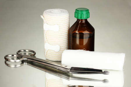 First aid kit for bandaging on grey background Stock Photo - 17864220