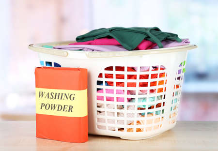 Clothes in plastic basket on table in room Stock Photo - 17864187