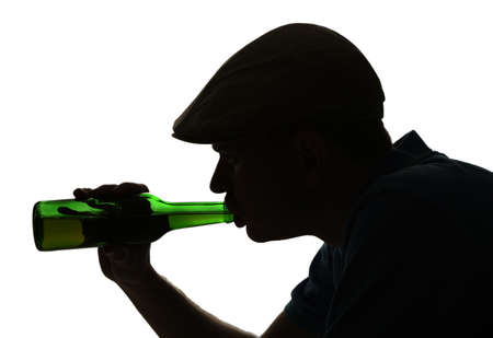 Silhouette of man drinking alcohol, isolated on white photo