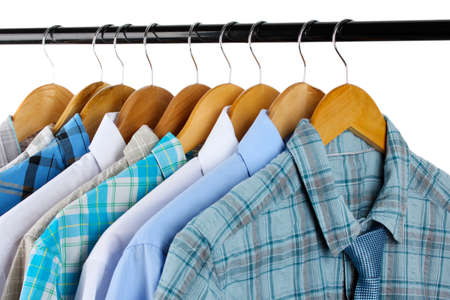 Shirts with ties on wooden hangers isolated on white photo