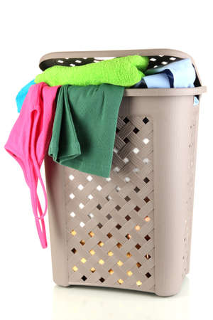 Beige laundry basket isolated on white photo