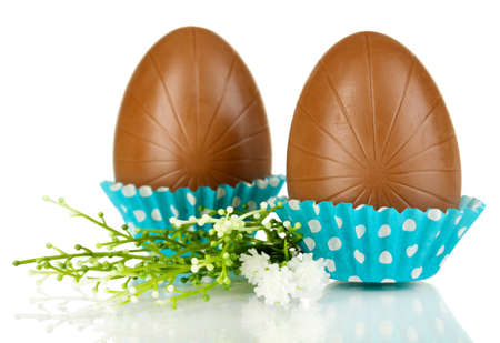 Chocolate eggs in napkin isolated on white photo