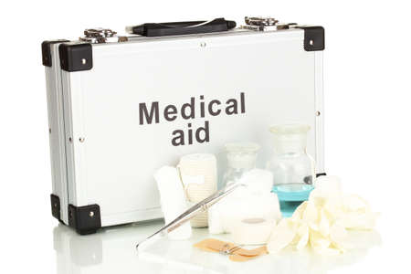 First aid kit for bandaging isolated on white photo