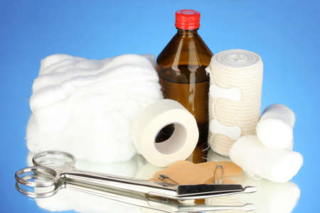 First aid kit for bandaging on blue background Stock Photo - 17864501