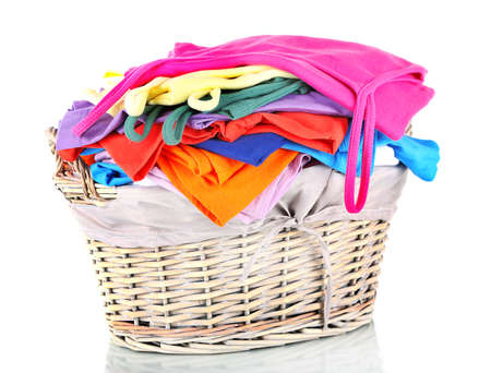 Clothes in wooden basket isolated on white Stock Photo - 17864566