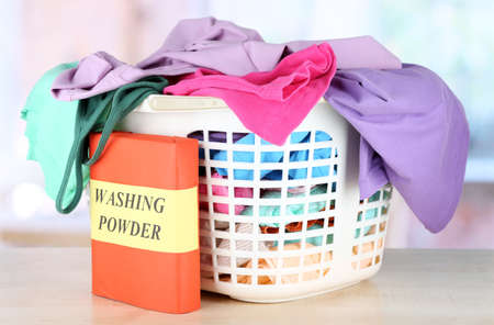 Clothes in plastic basket on table in room Stock Photo - 17864502