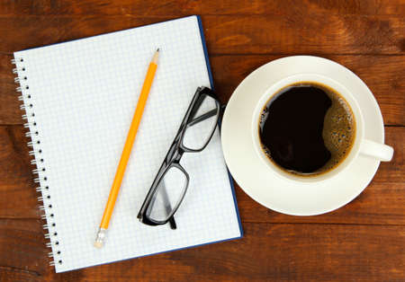 Cup of coffee on worktable covered with documents close up Stock Photo - 17864494