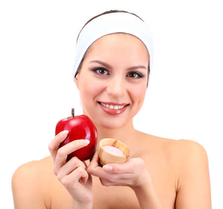 Young woman with fruit.Concept: Facial fruit masks. Isolated on white photo