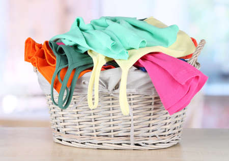 Clothes in wooden basket on table in room Stock Photo - 17944518