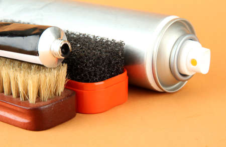 Set of stuff for cleaning and polish shoes, on color background Stock Photo - 17943836