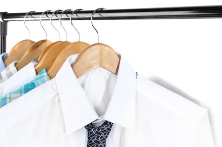 Shirts with ties on wooden hangers isolated on white Stock Photo - 17943705