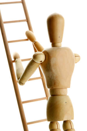 Mannequin on wooden ladder, isolated on  white Stock Photo - 17957912