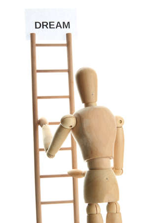 Mannequin on wooden ladder, isolated on  white photo