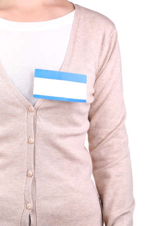 nametag: Blank nametag on girls clothes close up