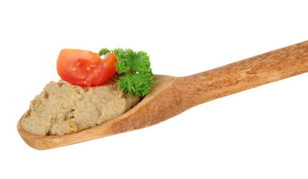 Fresh pate on wooden spoon, isolated on white photo