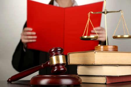 verdict: Judge read verdict on grey background Stock Photo
