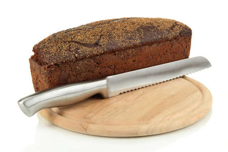 Black bread with sesame seeds and knife on wooden board isolated on white photo