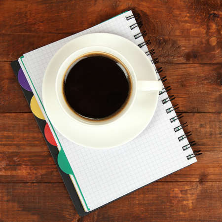 Cup of coffee on worktable close up photo