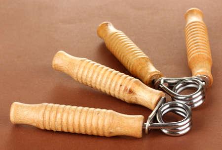 espander: Modern hand trainer on brown background
