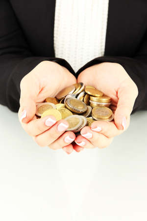 Woman hands with coins isolated on white  photo