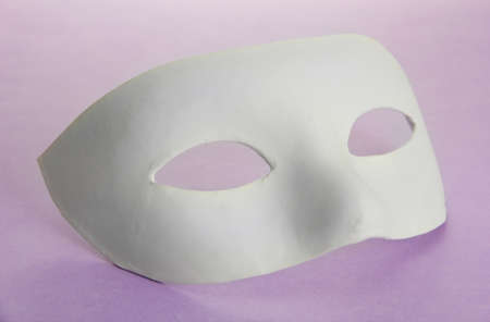 White mask, on purple background photo