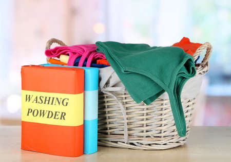 Clothes in wooden basket on table in room Stock Photo - 18041484