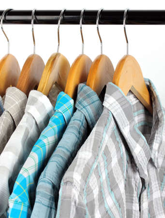 Shirts with ties on wooden hangers isolated on white Stock Photo - 18041592