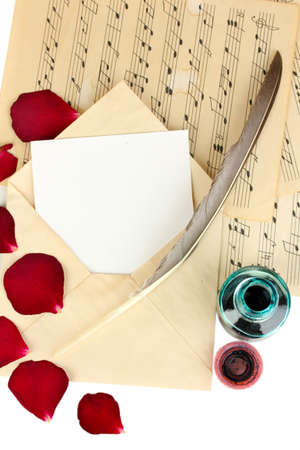 Old envelope with blank paper and dried rose petals on music sheets close up Stock Photo - 18042659