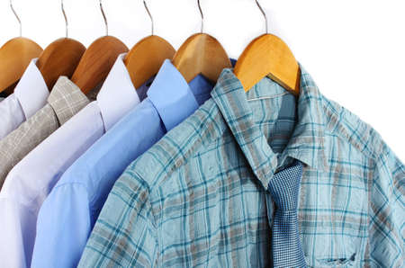 Shirts with ties on wooden hangers isolated on white Stock Photo - 18043214