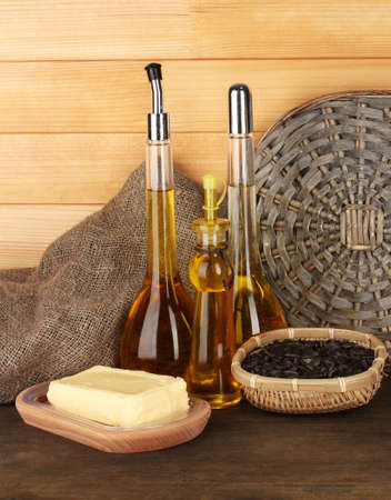 Different types of oil with sunflower seeds on wooden background Stock Photo - 18042827