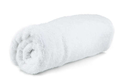 Rolled up white towel isolated on white photo