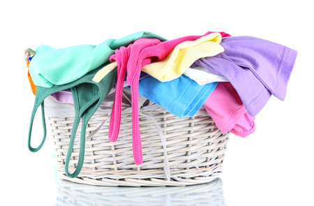 Clothes in wooden basket isolated on white Stock Photo - 18086517