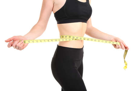 Woman measuring her waist isolated on white Stock Photo - 18086129