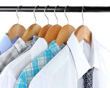 Shirts with ties on wooden hanger isolated on white Stock Photo - 18086267