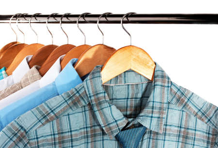Shirts with ties on wooden hangers isolated on white Stock Photo - 18081930