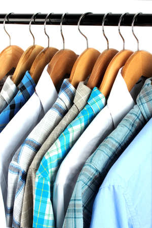 Shirts with ties on wooden hangers close-up photo