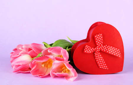 Pink tulips and gift box, on color background Stock Photo - 18072381