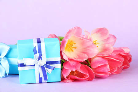 Pink tulips and gift boxes, on color background Stock Photo - 18072380