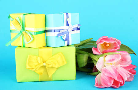 Pink tulips and gift boxes, on color background Stock Photo - 18072523