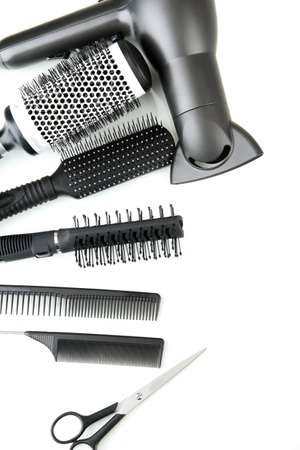 hairdresser cutting hair: Comb brushes, hairdryer and cutting shears, isolated on white