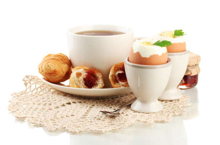 Light breakfast with boiled eggs and coffee, isolated on white photo