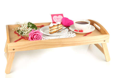 Breakfast in bed on Valentines Day isolated on white photo