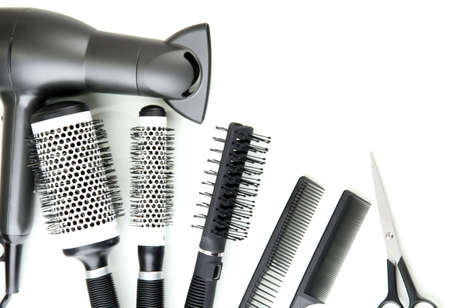 Comb brushes, hairdryer and cutting shears, isolated on white Stock Photo - 18138347