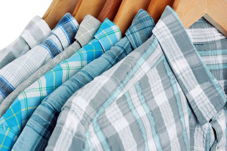 Shirts with ties on wooden hangers close-up Stock Photo - 18139402