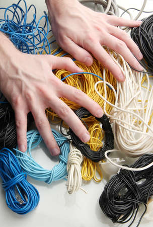 Cables and man hands, close up Stock Photo - 18139289